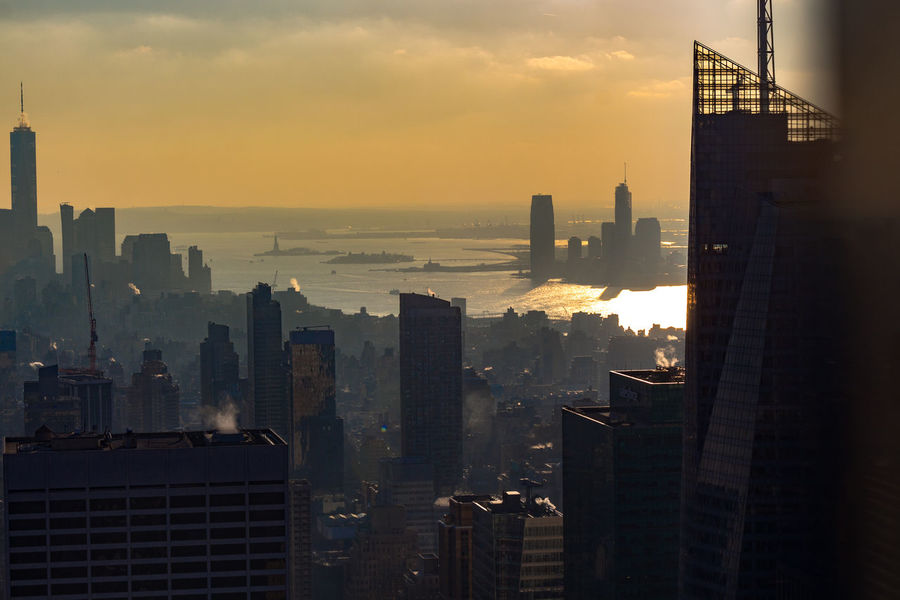 Building Cityscape Skyscraper Modern Travel Destinations New York Building Exterior Architecture Built Structure City Nature Orange Color Urban Skyline Tall - High Sunset No People Outdoors Sky Cloud - Sky High Office Building Exterior Water Tower Financial District