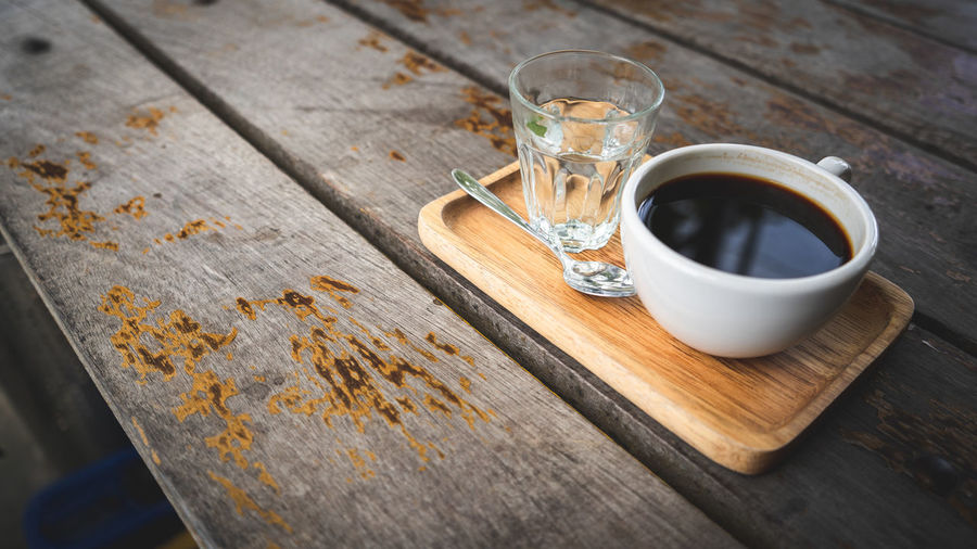 Coffee and sunlight Coffee Americano Coffee Cafe Coffee Coffee - Drink Coffee Cup Cup Day Drink Drinking Glass Food And Drink Freshness Glass High Angle View Household Equipment Indoors  Mug No People Refreshment Still Life Table Tea Cup Tray Water Wood - Material