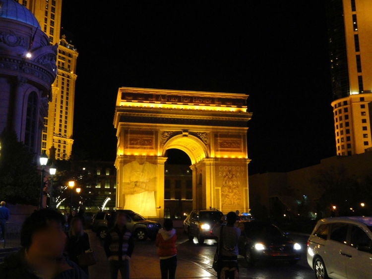 Arc De Triomphe Arch Architecture Building Exterior Built Structure Capital Cities  City City Life Entrance Famous Place History Illuminated International Landmark Monument Night Outdoors Paris Las Vegas Person Replica  Tourism Travel Travel Destinations Triumph Arch Triumphal Arch Vacations