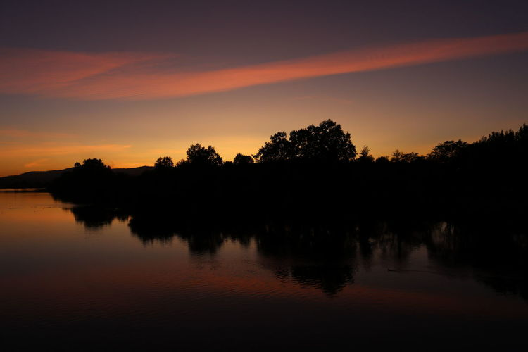 EyeEm Selects Reflection Sunset Lake Tree Landscape Dark Water Silhouette Sunsetporn Riverside Sunset_collection Sunset_captures Sunsetphotography Riverside Photography Nature Nature No People Outdoors Dawn Scenics Sky Night Perspectivechaser