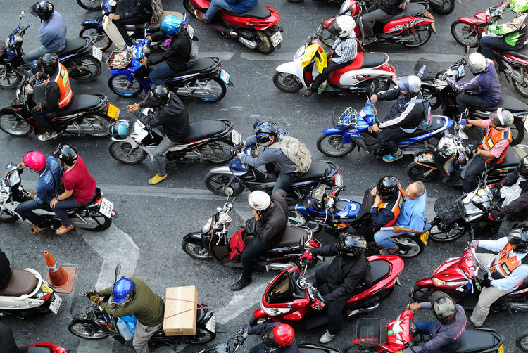 High Angle View Of People With Motorcycles On Road