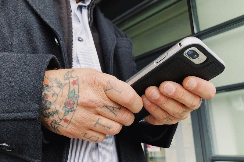 Colorful hands... Interaction Data Connection Online  Using Smartphone Touch Commerce Banking Texting Social Media Business Technology Using Phone Smartphone Tattoo One Person Real People Hand Men Lifestyles Holding Midsection Human Hand Human Body Part Communication Leisure Activity Wireless Technology Connection Finger Close-up