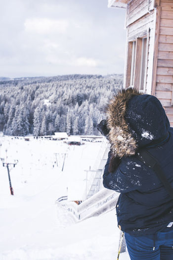 Finding the spot Beauty In Nature Building Exterior Built Structure Cold Temperature Day Landscape Leisure Activity Lifestyles Nature One Person Outdoors Real People Scenics Sky Snow Taking Photos Warm Clothing Weather Winter Woman Young Adult