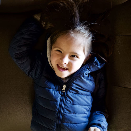 Real People One Person Indoors  Childhood Child Smiling Portrait Casual Clothing Front View Looking At Camera Lifestyles Happiness Leisure Activity Cute Emotion Clothing Waist Up Innocence Warm Clothing