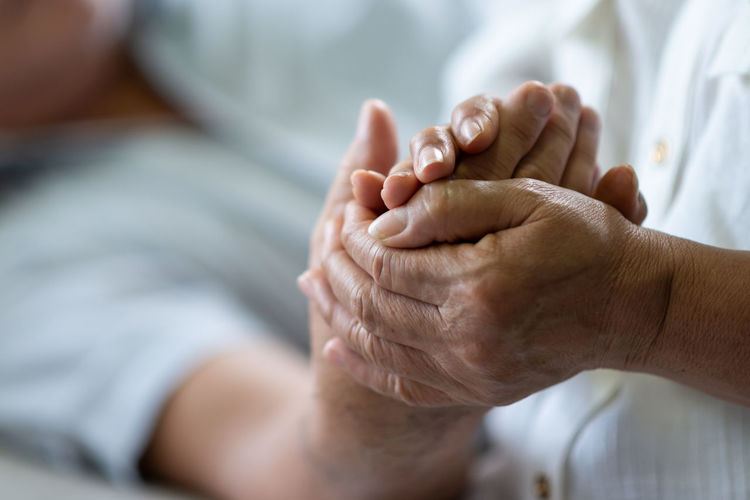 Asian Senior Couple holding hands illness, Comforting. Care Couple Females Grandfather Hands Hope Life Love Man Relationship Close Up Comfort Consoling Disability  Disease Elderly Grandmother Health Holding Illness Medical Older  Retirement Senior Wife