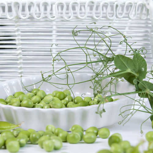Close-up of green peas on table