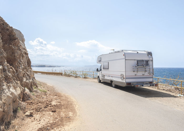 Journey Travelling Adventure Beach Beauty In Nature Camper Campervan Day Horizon Horizon Over Water Journey Land Land Vehicle Mode Of Transportation Motion Nature Outdoors Road Route Scenics - Nature Sea Sea View Sky Transportation Travel Water