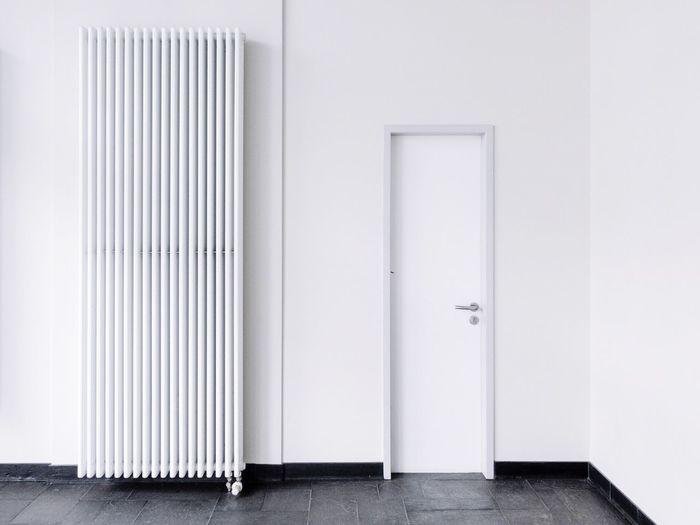 Radiator By Closed Door In Room