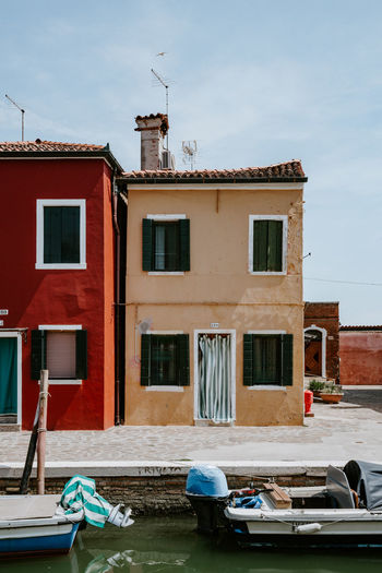 Colourful houses in Burano, Italy Architecture Building Building Exterior Built Structure Canal Car City Day Land Vehicle Mode Of Transportation Moored Motor Vehicle Nature Nautical Vessel No People Outdoors Residential District Sky Transportation Water Window