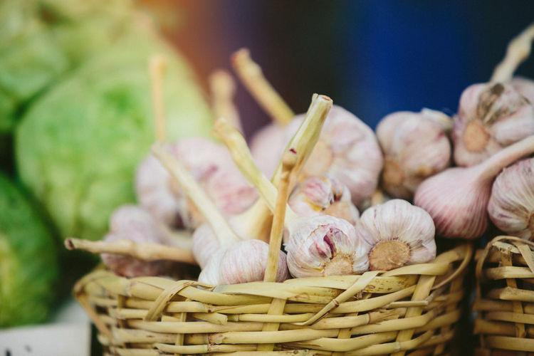 Close-up of garlic in basket