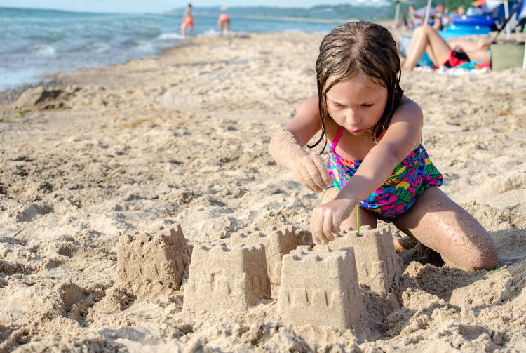 EyeEmNewHere Child Childhood Kid Beach Sand Sand Castle Playing Fun Creativity Summer Summertime Girl Female Concentrates Vacation