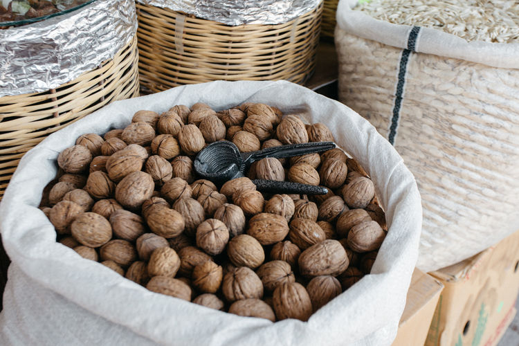 Close-up of walnuts in sack for sale at market