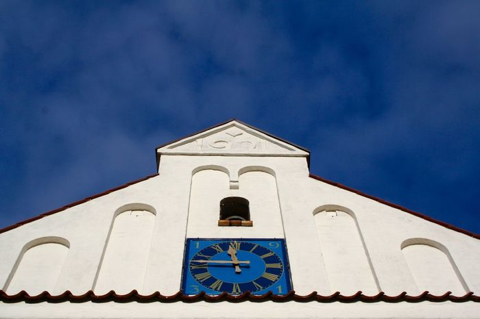 White church meets blue sky in Jutland, Denmark Low Angle View White Church Blue Bright Blue Sky Church Front Clock Contrast Day Look To The Sky Looking Above No People Place Of Worship Religion Spirituality