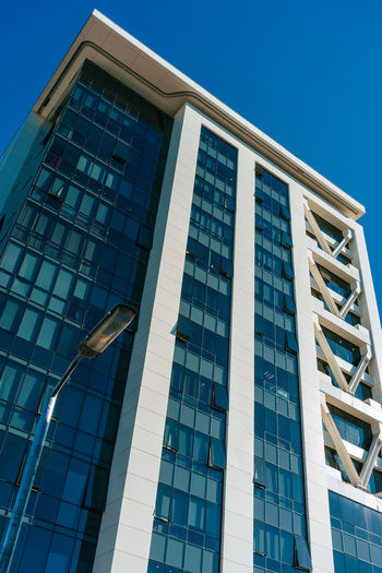 Low Angle View Built Structure Architecture Building Exterior Sky Building Window No People Modern Day Clear Sky City Office Building Exterior Nature Office Blue Outdoors Glass - Material Sunlight Reflection Skyscraper
