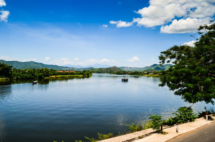 Sông Hương Beauty In Nature Blue Boat Cloud - Sky Day Huongriver Huế Idyllic Lake Lanscape Photography Mountain Nature Ngu Mountain No People Outdoors Scenics Sky Sonjewel Sonjewelphotographer Tranquil Scene Tranquility Travel Destinations Tree Vietnam Water