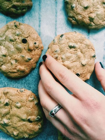 Close-up of woman hand holding cookies
