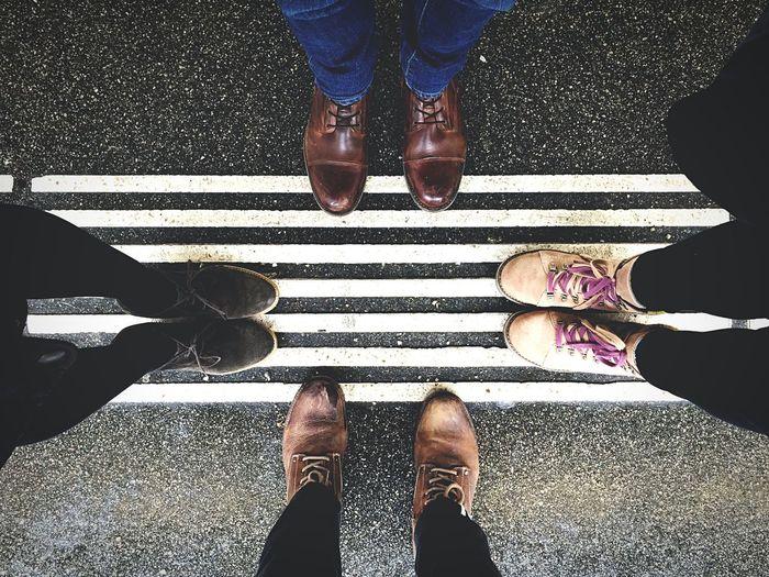 Directly below shot of friends standing on street