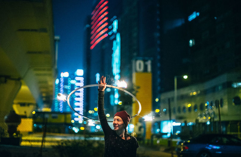 City City Life Fire Hula Hooping  Illuminated Neon Night Nightlife Only Women Outdoors Party - Social Event Performance Real People Skyscraper Women Around The World #urbanana: The Urban Playground