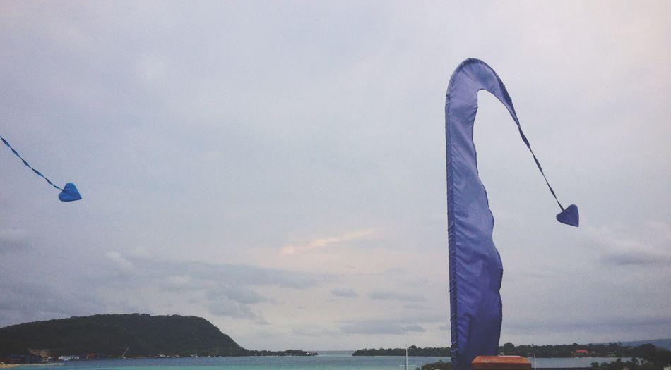 Man by sea against sky