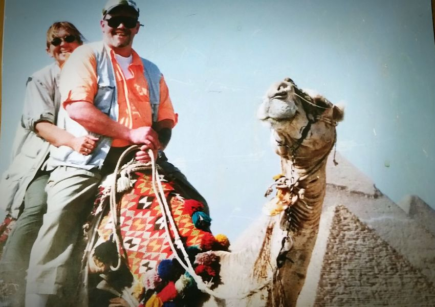 Two People Adult Vacations Outdoors Smiling Camel Pyramids Cairo, Egypt Riding A Camel