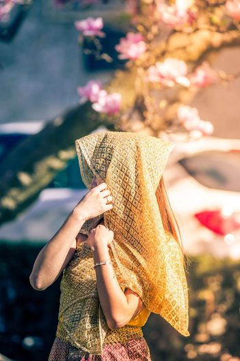 Woman with face covered by traditional clothing