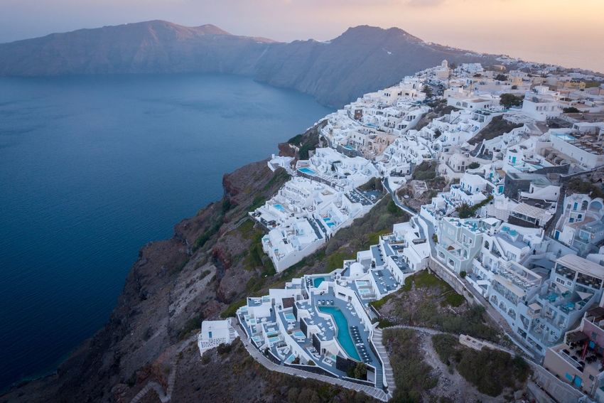 Santorini, Greece Water City Architecture Building Exterior Sea Built Structure High Angle View Scenics - Nature Nature No People Cityscape Building Beauty In Nature Mountain Beach Travel Destinations Outdoors