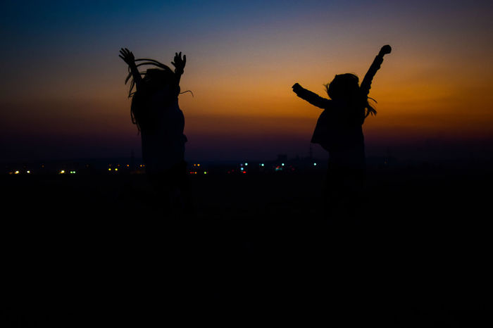 just relax and have fun. Beautiful Nature Beautiful Woman Doctors Girls Illuminated Leisure Activity Lifestyles Nature Night Outdoors People People Photography Real People Scenics Silhouette Sky Sunset Togetherness Stories From The City