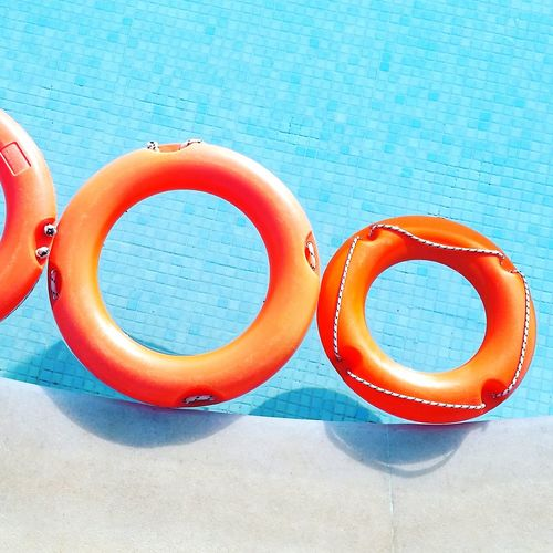 High angle view of life belts floating on swimming pool