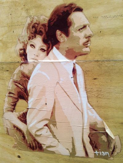 Sophia Loren and Marcello Mastroianni.. photo taken on Tib St, Manchester. The lengths that people go to to brighten up the inner city never ceases to amaze. Sophia Loren Marcello Mastroianni Cut Out Stencil Wood Street Art Vandalism Inner City Urban Street Art Tib Street Manchester