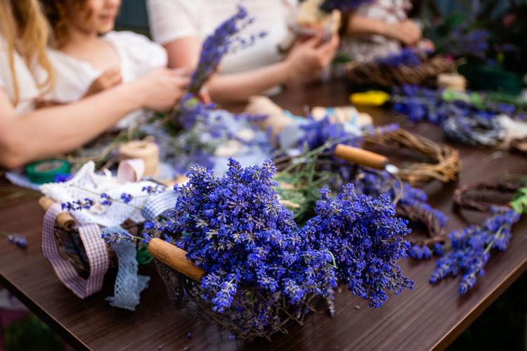 Group of people on purple flowering plants