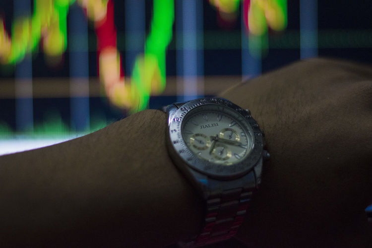 See stock chart time See Stock Chart Time Watch Wristwatch One Person Human Body Part Human Hand Time Close-up Hand Real People Indoors  Body Part Number Unrecognizable Person Focus On Foreground Lifestyles Accuracy Personal Accessory High Angle View Travel
