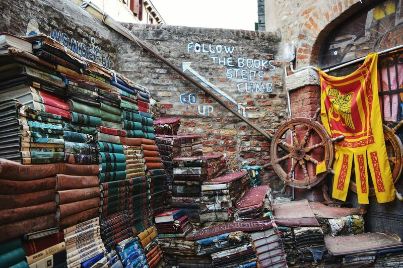 #Venice #libreriaacuqaalta #Amazing #travel #traveldestinations #beautifuldestinations #VENEZIA #explore #EyeEmNewHere #landscape #nature #photography #streetphotography #throwback City Multi Colored Store Text Building Exterior Built Structure Street Art