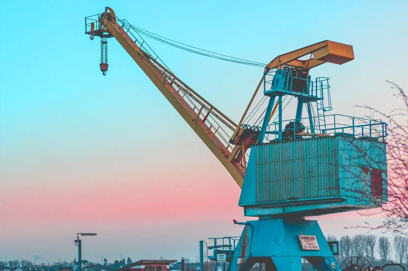 Views Crane - Construction Machinery Industry Business Finance And Industry Construction Site Construction Machinery Sky Low Angle View Oil Pump Shipyard Manufacturing Equipment Architecture No People Day Picking Up Working Sunset Machinery Outdoors