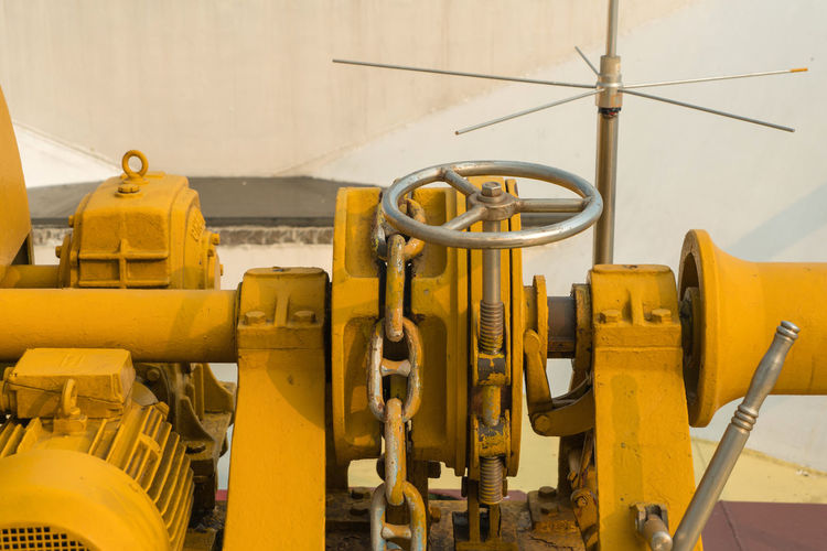 Yellow machine part in factory