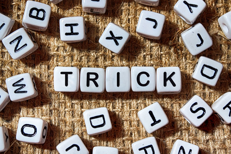Directly Above View Of Trick Text On Blocks