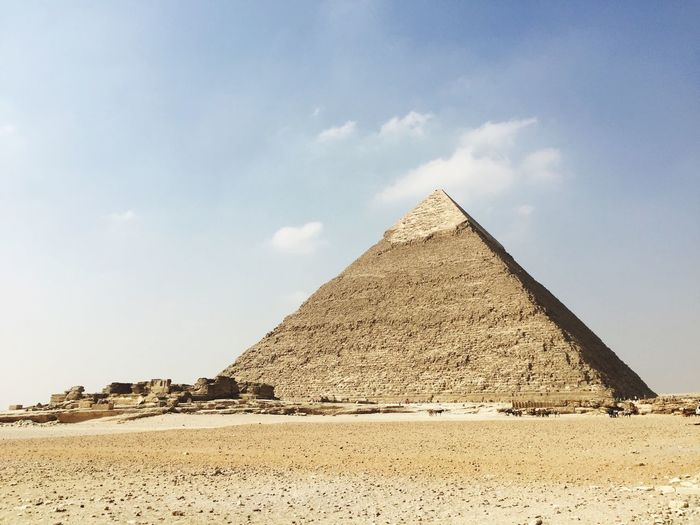 Great pyramid of giza at desert against sky