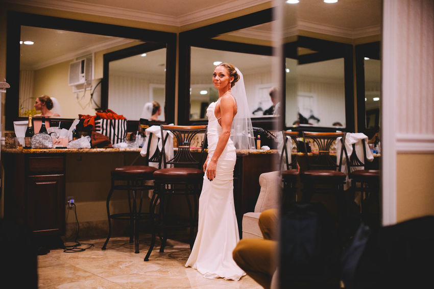 Adult Bride Business Celebration Couple - Relationship Evanscsmith Event Furniture Indoors  Lifestyles Men Mid Adult People Photographerinlasvegas Preparation  Real People Seat Table Wedding Wedding Dress Women Young Adult