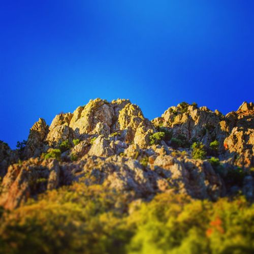 Mountains in the middle of nowhere Clear Sky Blue Rock - Object Leopard Nature Reserve Sky Landscape Extreme Terrain Arid Landscape Arid Climate Natural Landmark Atmospheric Geology Rocky Mountains Canyon Mountain Peak Physical Geography Sandstone Rugged