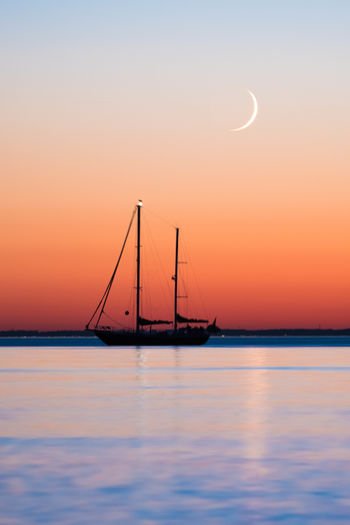 Crescent over Baltic Sea Baltic Sea Beauty In Nature Crescent Crescent Moon Horizon Over Water Moon Nature Nautical Vessel Night No People Outdoors Sailboat Scenics Sea Silhouette Sky Sunset Tranquil Scene Tranquility Travel Destinations Water Waterfront Live For The Story Been There. An Eye For Travel