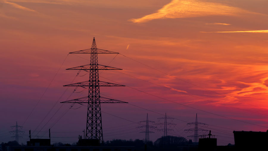 Electricity Pylon silhouette over dramatic orange sunset sky Sunset Sky Cloud - Sky Orange Color Technology Silhouette Electricity Pylon Connection Electricity  Low Angle View Nature No People Beauty In Nature Cable Power Line  Fuel And Power Generation Architecture Power Supply Outdoors Built Structure Sailboat Romantic Sky