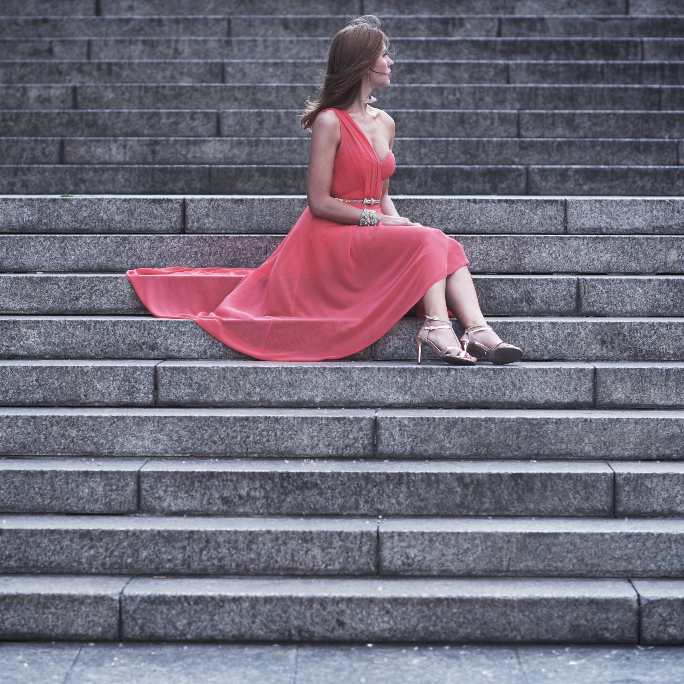 steps, full length, lifestyles, casual clothing, steps and staircases, red, building exterior, staircase, striped, built structure, architecture, standing, brick wall, leisure activity, side view, stairs, young adult, day
