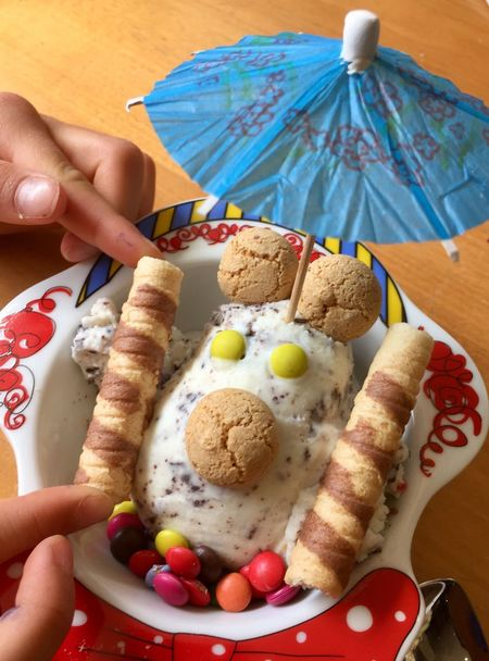 Ice cream sundae with decoration for kids Chocolate Chips Stracciatella Sweet Food Dessert Birthday Kids Decoration Paper Umbrella Cookie Wafer Rolls Ice Cream Sundae Sundae Ice Cream Funny Face Human Hand Food Food And Drink Hand Human Body Part One Person Freshness Holding Indoors  Table Ready-to-eat Plate