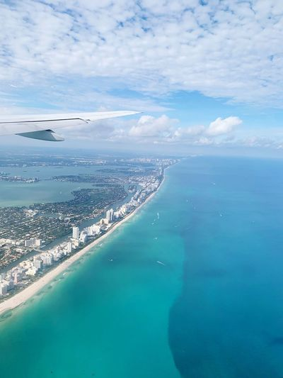 Miami in the air Miami Avion In The Air Flying Water Sea Scenics - Nature Beauty In Nature Cloud - Sky Sky Nature Aerial View Coastline