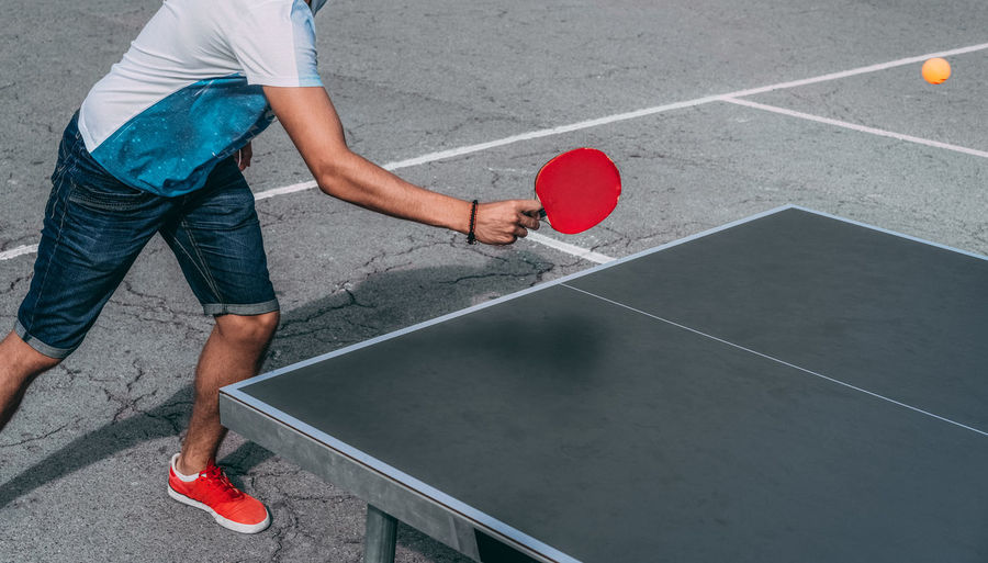Sport Playing Healthy Lifestyle Adult Ping Pong Leisure Games Human Body Part The Week On EyeEm People One Person One Man Only Net - Sports Equipment Ping Pong Ball Ping Pong Table