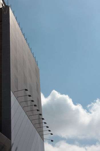 Low angle view of a building against sky with blank adv area and copy space
