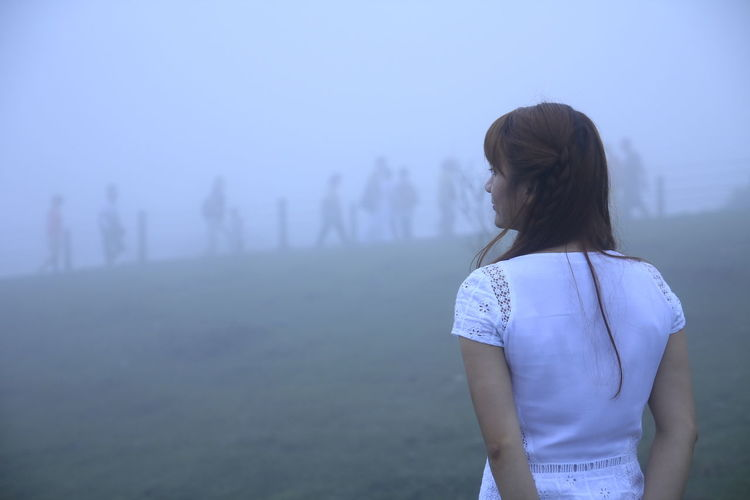 Real People Fog Lifestyles Standing Leisure Activity Hairstyle Women One Person Land Waist Up Casual Clothing Long Hair Focus On Foreground Nature Three Quarter Length Rear View Adult Young Adult Outdoors White Clothes The Portraitist - 2019 EyeEm Awards