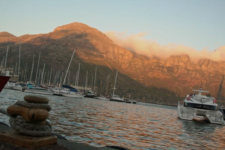 Beauty In Nature Boat Boats And Moorings Cape Town Clear Sky Lake Marine Life Mode Of Transport Moored Mountain Mountain Range Mountains Nature Nautical Vessel River Rock - Object Scenics Sea Sky Tranquil Scene Tranquility Transportation Water Waterfront