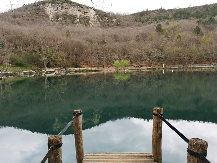 Water Reflection Lake Tranquility Tree Tranquil Scene Plant Wood - Material Nature Day No People Beauty In Nature Scenics - Nature Non-urban Scene Sky Railing Outdoors Land Standing Water Sinizzo