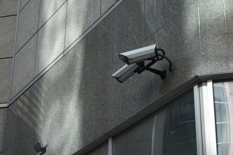 Closed-circuit television, surveillance camera on building exterior