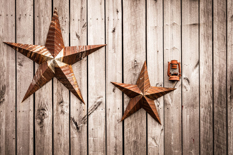 Close-Up Of Star Shape Decorations Of Wooden Wall